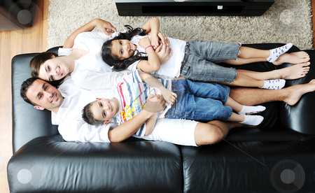 Young family at home stock photo, happy young family relax and have fun at modern home indooor by Benis Arapovic