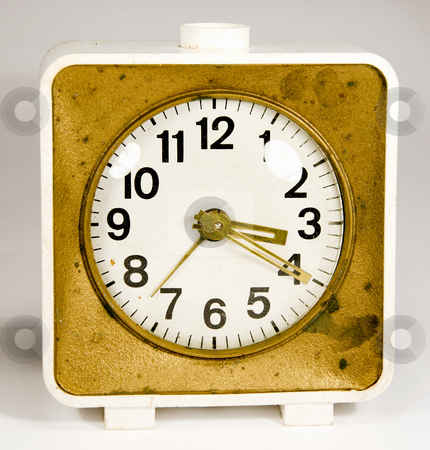 Ancient alarm clock. stock photo, Ancient clock with three arrows showing 3:20. Old white gold alarm clock. by sauletas