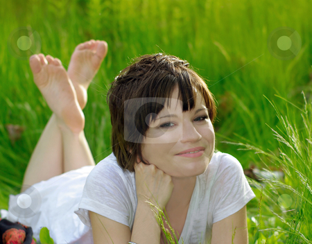 Natural beauty stock photo, caucasian girl in white summer dress relaxing outdoors on a breezy day in sunshine on green grass  field. (motion of grass due to wind blowing)  by JOSEPH S.L. TAN MATT