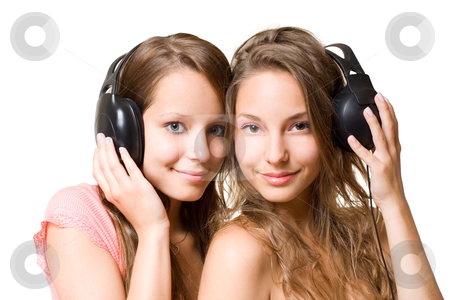 Teen radio. stock photo, Teen radio, two gorgeous cute brunette teen girls having fun with headphones and music, isolated on white background. by exvivo