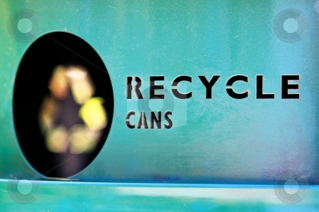 Recycle cans stock photo, Close up of a garbage bin for recycling cans. by Henrik Lehnerer