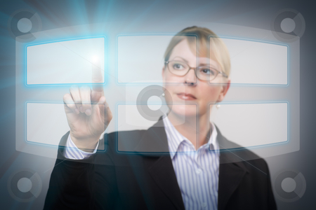 Woman Pushing an Interactive Touch Screen stock photo, Attractive Blonde Woman Using an Interactive Touch Screen. by Andy Dean