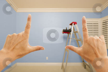 Hands Framing Blue Painted Wall Interior stock photo, Hands Framing Blue Painted Room Wall Interior with Ladder, Paint Bucket and Rollers. by Andy Dean