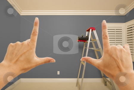 Hands Framing Grey Painted Wall Interior stock photo, Hands Framing Grey Painted Room Wall Interior with Ladder, Paint Bucket and Rollers. by Andy Dean