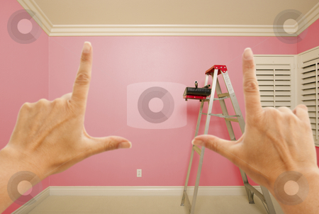 Hands Framing Pink Painted Wall Interior stock photo, Hands Framing Pink Painted Room Wall Interior with Ladder, Paint Bucket and Rollers. by Andy Dean
