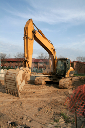 Backhoe at a Construction Site stock photo, A backhoe at a new housing development.  by Chris Hill