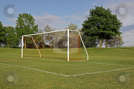 Empty Football Net stock photo, An empty soccer goal with trees in the background.  by Chris Hill