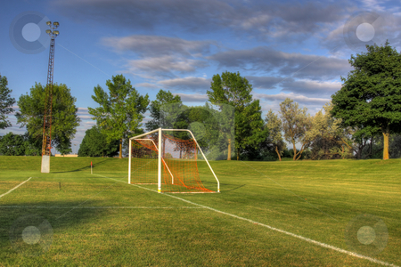 Soccer Net Side-view stock photo, An empty soccer goal with trees in the background. (HDR photo)  by Chris Hill