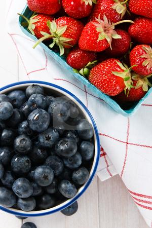 Summer Strawberries and Blueberries stock photo, Overhead view of ripe summer strawberries and blueberries by Karen Sarraga