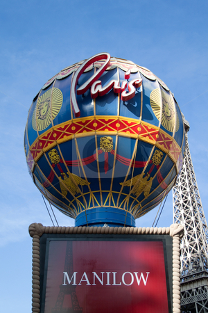 Paris Hotel and Casino stock photo, December 30th, 2009 - Las Vegas, Nevada, USA - The Paris Hotel and Casino sign on Las Vegas Boulevard featuring Barry Manilow by Kevin Tietz