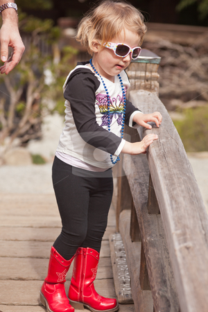Maya in red boots stock photo, First spring walk in park on sunny day. by Mariusz Jurgielewicz