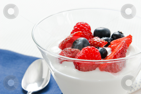 Berries and Yogurt stock photo, Close up view of berries and yogurt with shallow depth of field and copy space. by Karen Sarraga