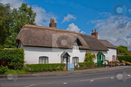 Thatched Roof English Cottage stock photo, Traditional English country cottage exterior with flowers on display. by liverbird