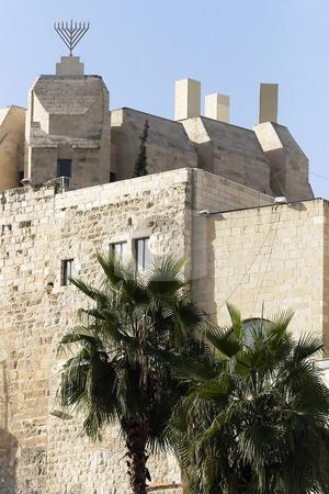Ancient Walls Surrounding Old City stock photo, Ancient Walls Surrounding Old City in Jerusalem with menorah above by Tatjana Keisa