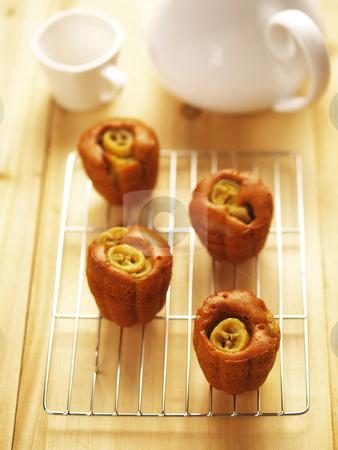 Banana cupcakes stock photo, freshly baked banana cupcakes by zkruger