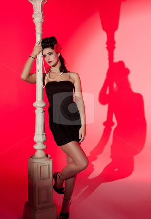 Young woman and lightpole stock photo, beautiful young glamorous woman  with lightpole by Phil Morley
