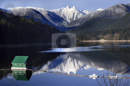Capilano Reservoir Lake Snowy Two Lions Mountains Vancouver Brit stock photo, Capilano Reservoir Lake Green Building Dam Snowy Two Lions Snow Mountains Vancouver British Columbia Pacific Northwest by William Perry