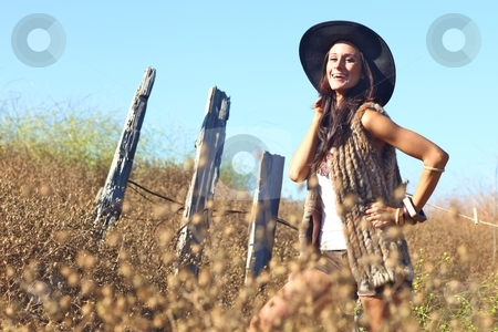 Young Beautiful Woman on a Field in Summer Time stock photo, Beautiful Woman in a Field During Summer With Hat by Katrina Brown