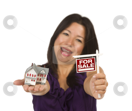 Multiethnic Woman Holding Small For Sale Real Estate Sign and Ho stock photo, Multiethnic Woman Holding Small For Sale Real Estate Sign and House in Hand Isolated on White Background. by Andy Dean