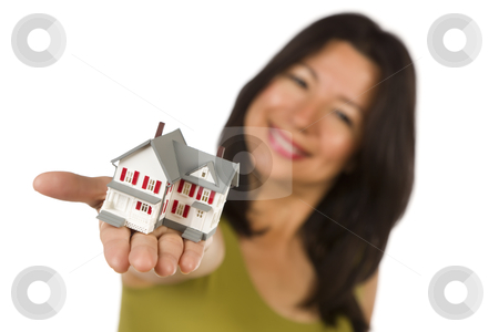 Attractive Multiethnic Woman Holding Small House stock photo, Attractive Multiethnic Woman Holding Out In Front of Her a Small House Isolated on a White Background. by Andy Dean
