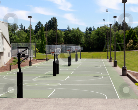 Time to Play stock photo, Many green floor basketball courts all together outdoors with partly coudy sunny sky landscape in summer. by Lee Serenethos