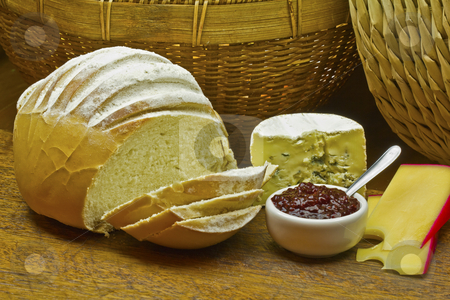 Bread cheese and red jelly stock photo, Bread, camembert cheese and red jelly over a wood table by marphotography