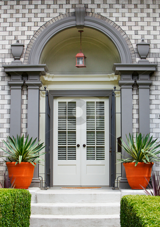 Elegant Home Front Door stock photo, Elegant Home Front Door with gray wood arch and alternating brick work pattern by bobkeenan