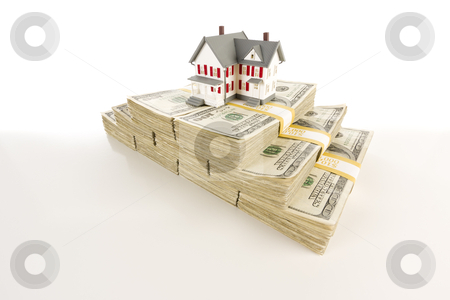 Small House on Stacks of Hundred Dollar Bills stock photo, Stacks of One Hundred Dollar Bills with Small House on Slight Gradation. by Andy Dean