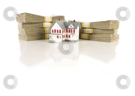 Stacks of Hundreds with Small House stock photo, Stacks of One Hundred Dollar Bills with Small House on Slight Reflective Surface. by Andy Dean