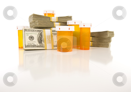 Medicine Bottles and Stacks of Hundreds of Dollars stock photo, Empty Medicine Bottles and Stacks of Hundreds of Dollars on Reflective Surface. by Andy Dean