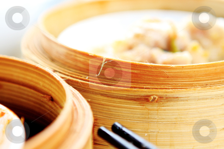 Chinese dim sum stock photo, chinese dim sum,foucs on the bamboo steamer by Keng po Leung