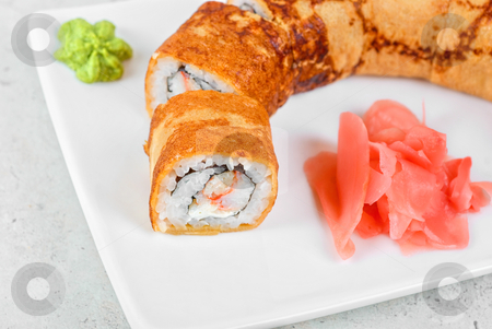 Omelette sushi stock photo, Sushi - made of crab meat, cheese, omelette outside by olinchuk