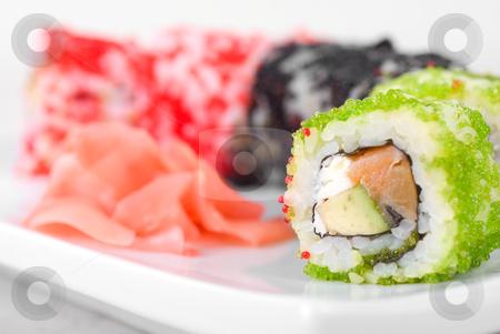 Sushi rolls stock photo, Sushi rolls made of salmon, avocado, flying fish roe (tobiko caviar) and philadelphia cheese by olinchuk