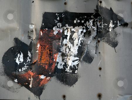 Black and Orange Graffiti stock photo, Black, orange and white graffiti on a metal wall. by Chris Hill