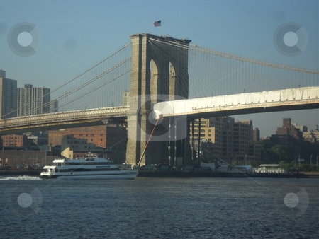 Brooklyn Bridge  stock photo, Tourist boat going under the Brooklyn Bridge, view of Brooklyn by angiejgray