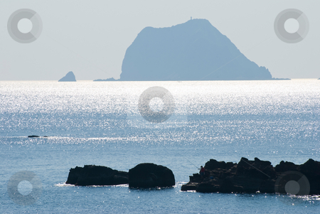 Island and little boat stock photo, Island and little boat with sun light reflection in the morning by Lawren