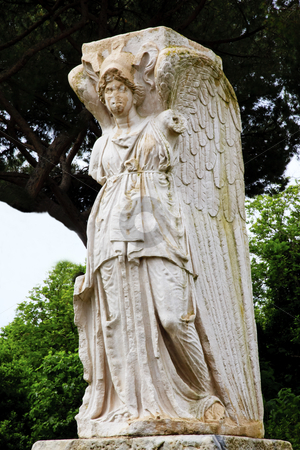 Ancient Roman Angel Statue Ostia Antica Rome Italy stock photo, Ancient Roman Angel Statue Ostia Antica Ruins Rome Italy Excavation of Ostia, ancient Roman port, next to airport.  Was port for Rome until 5th Century AD.  by William Perry