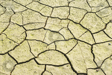 Drought land was cracked. stock photo, Drought land was cracked. The lake is drying.  by Lawren
