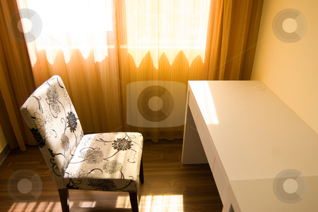 Sunlight in empty room stock photo, Empty room with single table and chair under sunlight by Lawren