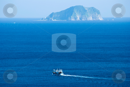 Little fisher boat goes through island stock photo, Little fisher boat goes through island in the morning by Lawren