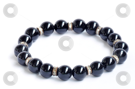 Bracelet of black pearls stock photo, Bracelet made of black pearls on a white background by John Young