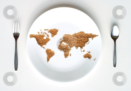 World Map of Grain  stock photo, A world map made of pieces of Spelt grain on a white plate symbolizing concepts of trade, world hunger, poverty, globalization. by Great Divide Photography
