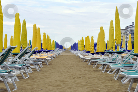 Umbrellas stock photo, Umbrellas on the beach in Italy by freeteo