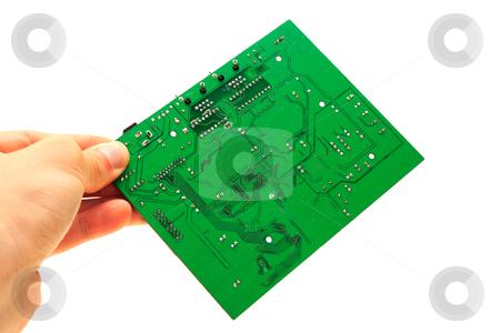 Human hand holding green computer circuit board stock photo, Human hand fingers holding green computer circuit board by vetdoctor