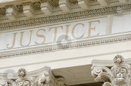 Justice word engraved stock photo, justice word engraved on the pediment of the courthouse by Angelstorm