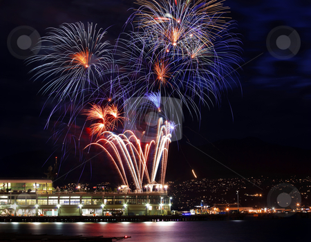 Red Blue White Fireworks Vancouver Harbor British Columbia stock photo, Red Blue White Fireworks Vancouver Harbor Canada Day British Columbia Pacific Northwest by William Perry