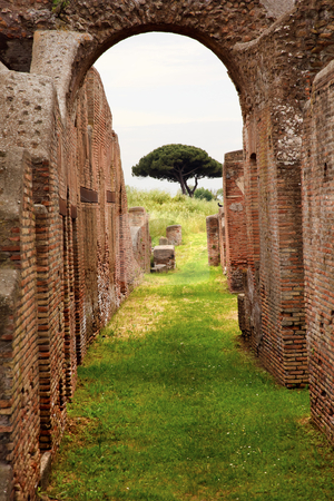 Ancient Roman Arch Walls Street Ostia Antica Rome Italy stock photo, Ancient Roman Arch Walls Street Ostia Antica Ruins Rome Italy Excavation of Ostia, ancient Roman port, next to airport.  Was port for Rome until 5th Century AD.  by William Perry