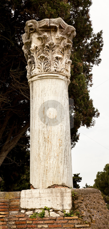Ancient Roman Column Ostia Antica Rome Italy stock photo, Ancient Roman Column With Stone Mask Ostia Antica Ruins Rome Italy Excavation of Ostia, ancient Roman port, next to airport.  Was port for Rome until 5th Century AD.  by William Perry