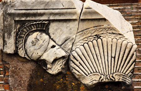 Ancient Roman Decorations Helmet Ostia Antica Rome Italy stock photo, Ancient Roman Decorations Helmet Ostia Antica Ruins Rome Italy Excavation of Ostia, ancient Roman port, next to airport.  Was port for Rome until 5th Century AD.  by William Perry