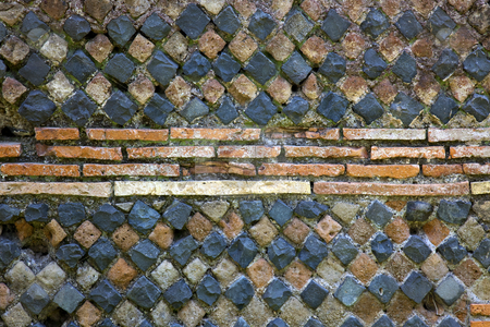 Ancient Roman Stone Wall Background Ostia Antica Rome Italy stock photo, Ancient Roman Stone Wall Background Ostia Antica Ruins Rome Italy Excavation of Ostia, ancient Roman port, next to airport.  Was port for Rome until 5th Century AD.  by William Perry